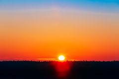sun-over-horizon-sunset-sunrise-background-50937335